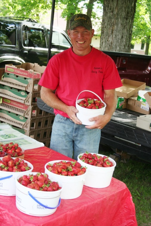 Ryan Nelson with buckets of strawberries